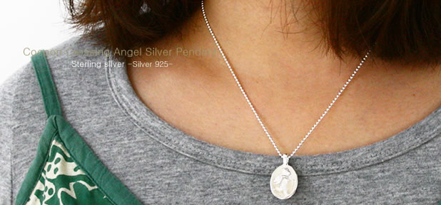 Cocoon Crossing Jog Angel Silver Pendant