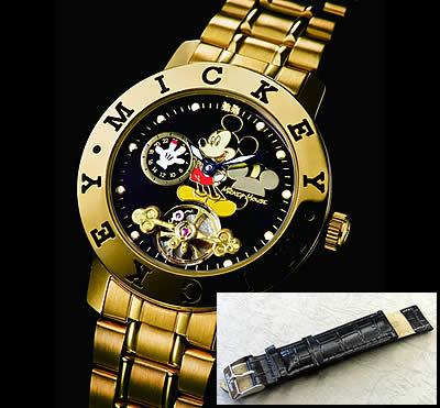 ゴールドの時計本体はステンレスベルトとブラックの牛革ベルトが付いています。