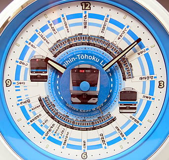 京浜東北線駅メロ目覚時計は磯子〜上野間の各駅を、快速電車所要時間57分の駅名を配置したデザイン