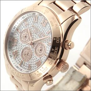 マイケル コース  煌びやかなパヴェストーンをまとったラグジュアリーな大きめサイズのレディス腕時計。 MK5946