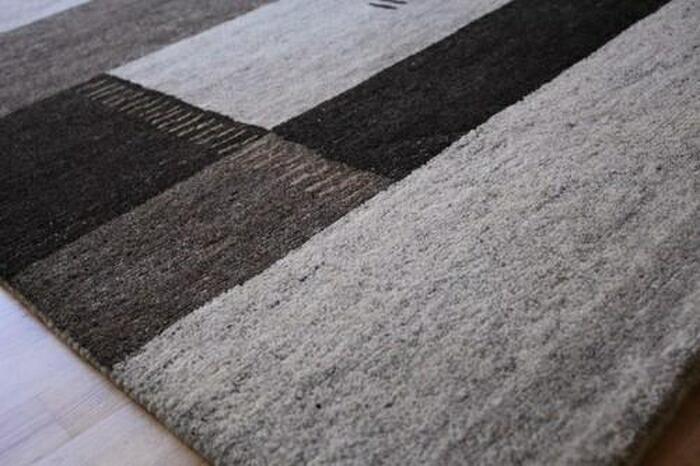 在手工编织地毯由位于西南的伊朗伊斯兰共和国境内的游牧部落,ruriko