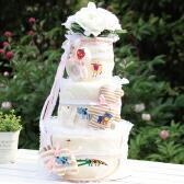 トップのフラワーがケーキ感を演出、おむつが選べるオーガニックアモローサおむつケーキ