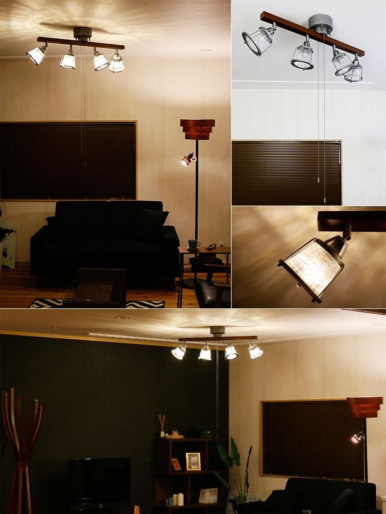 スチールとウッドの組み合わせがかっこいい雰囲気を作り出しています。ブラックのソファ、モノクロの幾何学模様ラグ、ガラスのテーブルと組み合わせています。