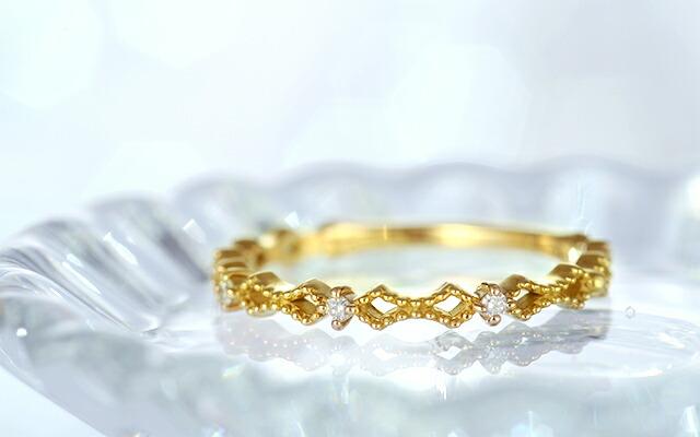 K18 diamond ring earnest