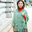 The soft and fluffy knit poncho of two colors of marble designs! Wood button and the plentiful fringe that the food such as the や knit cap creates on nanoco-らしさを plonk are cardigan ◆ ジェネールフリンジニットポンチョ which a shawl style can dress well of the accent