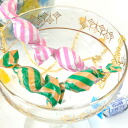 A genuine article! ? A pop necklace of the candy that two formed a line which the wrapper of the stripe pattern that I concluded tightly has a cute. Sweets cake accessories Lady's ◆ stripe candy necklace