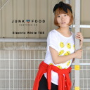 The silhouette which is rough on とろけるにこちゃん print. MADE IN U.S.A cut-and-sew Lady's ◆ Junk Food (junk food) Electric White T-shirt [Lady's] made in rough T-shirt short sleeves smile U.S.A. of the longish length & up in front hem