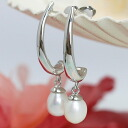 It is pretty, and a white pearl shakes on elegant design metal fittings in freshwater pearl long pierced earrings Stai Risch.