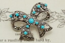 Antique design of the ribbon that turquoise & seed pearl ribbon broach is Lacey softly