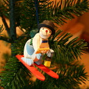 [Christmas:] Snowman of Christmas] Graupner ornament, a red ski