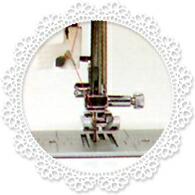 自動糸通し器