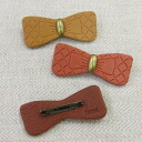 Kanmi. Baked Ribbon brooch
