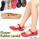 Floral punch style rubber sandals