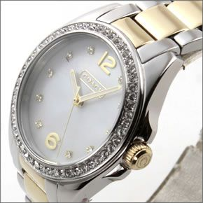 コーチ  ダイヤルにはシェルの輝きとラインストーン☆ラグジュアリーなレディス腕時計 14501659