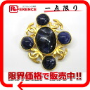 "Chanel 95A stone brooch gold / Navy beauty products ""enabled."""