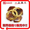 "Chanel 94 p brooch gold / Brown ""response."""