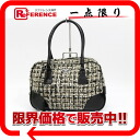 "Prada logo plate Tweed handbags ""response."""