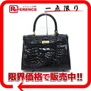 "Crocodile handbag black ""response."""