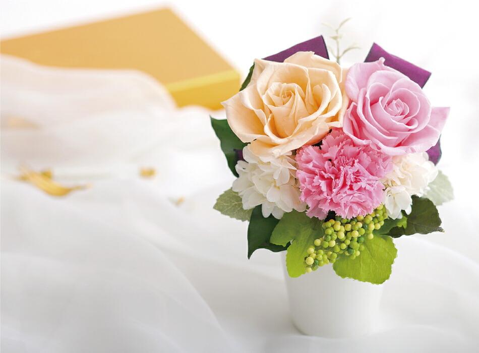 バラとリボンのアレンジメント ミックスの画像
