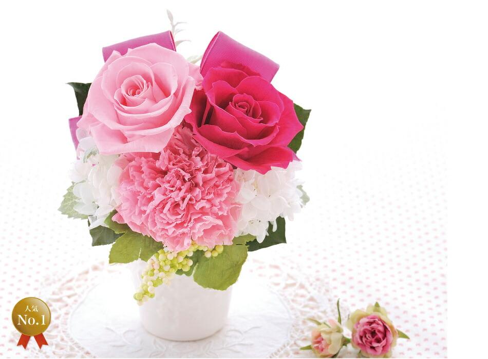 バラとリボンのアレンジメント ピンク×フューシャピンクの画像