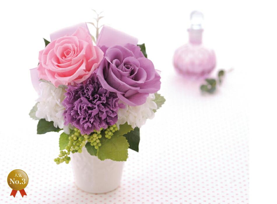バラとリボンのアレンジメント ピンクパープルの画像