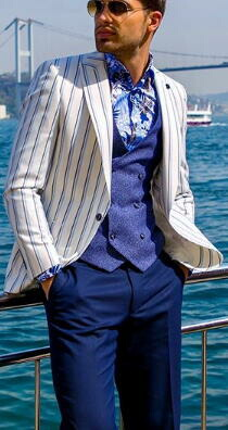 ポリンピア 白地に水色と紺のストライプがとても爽やかな、背抜きのサマージャケット