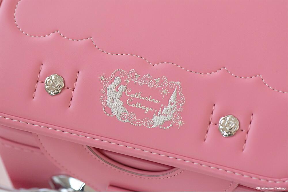 バラモチーフの金具とシンデレラの刺繍