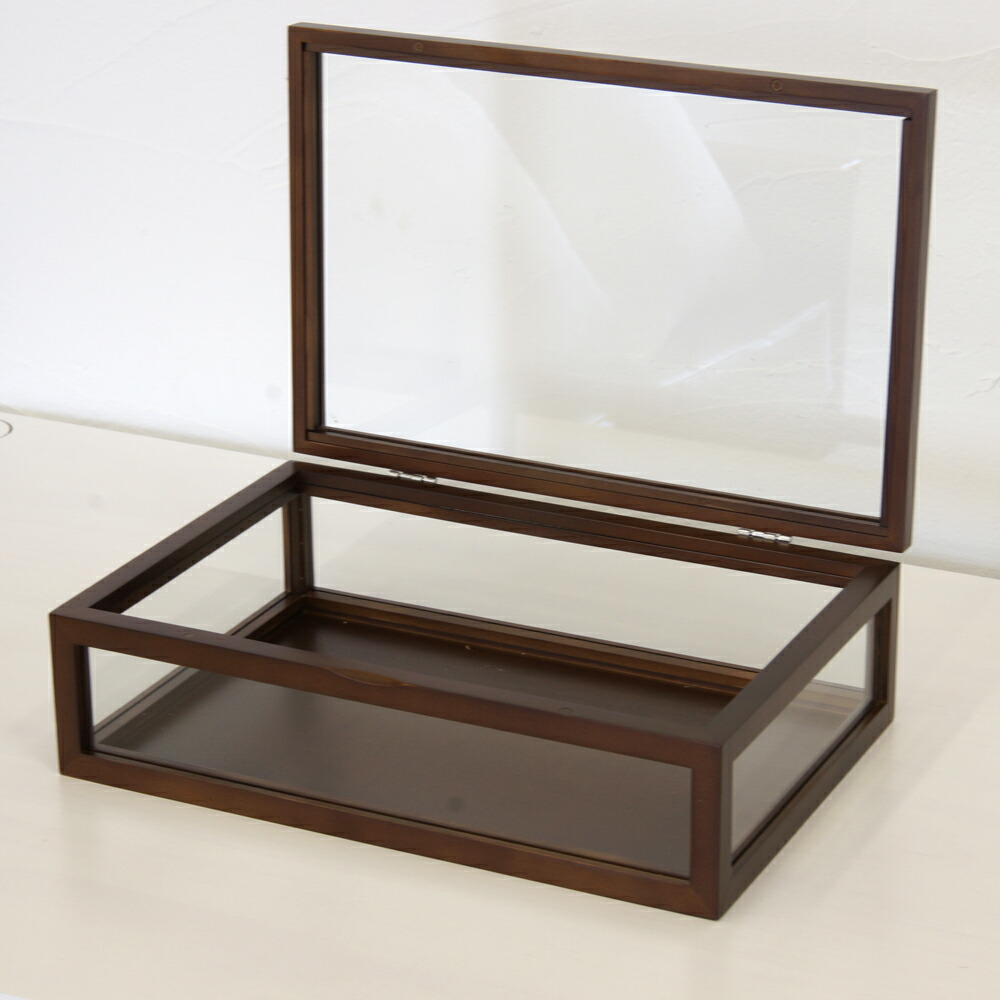 Glass Display Box Features; Simple way to store memorabilia and other small mementos. Use as a display case for a wide assortment of decorations. Three sizes are currently available for tons of storage. Individually sold. Contemporary design adds style to most any home decor.