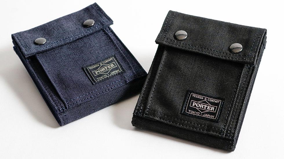 36cb4de18a4c 墨黒と呼ばれる淡いブラックカラーがデザインを引き立てる、小物からビジネス、カジュアルと数多く揃う人気シリーズ『SMOKY/スモーキー』の二つ折り財布。