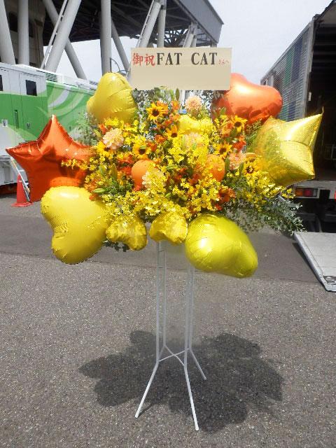 お祝い暖色系明るいバルーンスタンド花