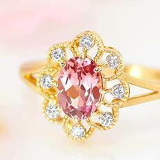 ペアシェイプマラヤガーネットとダイヤモンドのK18リング(指輪)