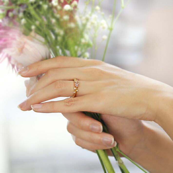 オーバルカット桜色マラヤガーネットの18金リング
