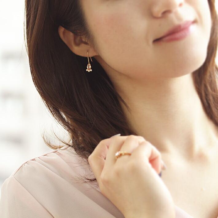 オーバルカット桜色マラヤガーネットの18金ピアス