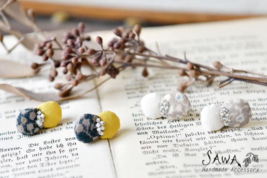 【SAWA  サワ × merinomi メリノミ】コラボ 木の実と小さな蝶 クロス ピアス