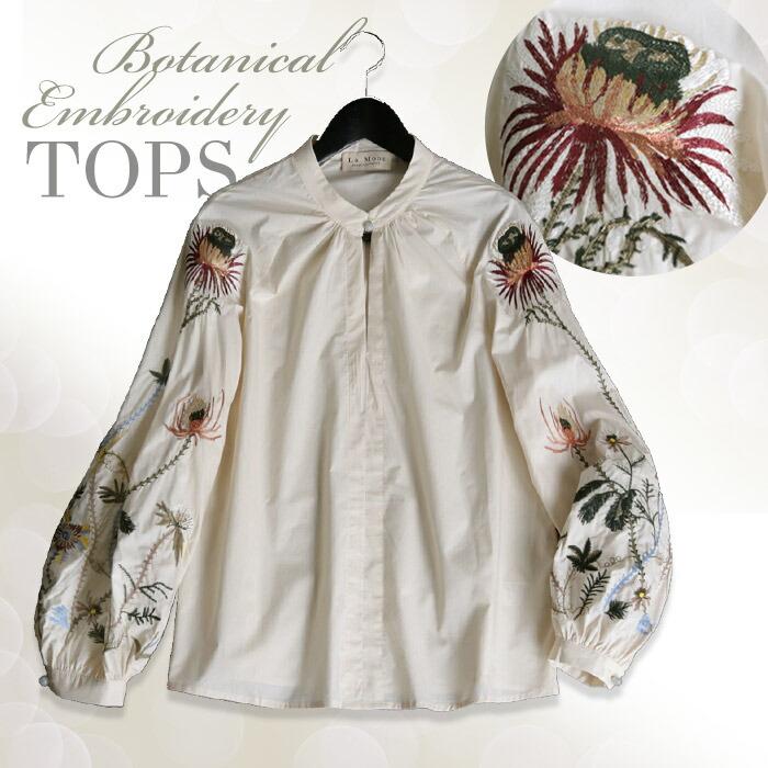 袖のボタニカル柄刺繍が個性的なトップス