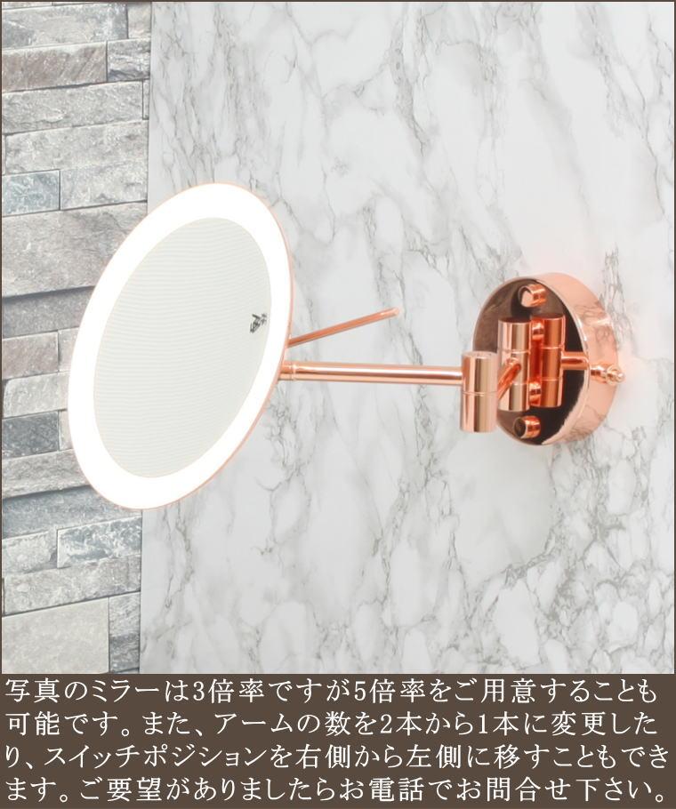 拡大する鏡でライトがつくホテルにあるミラー