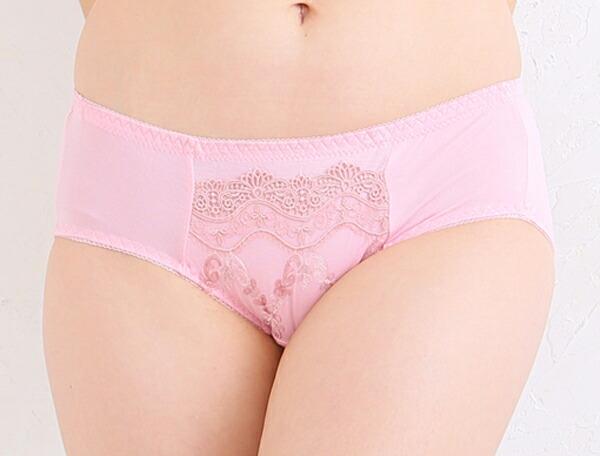 脇肉を補正しながら育乳する大きいサイズの脇肉補正下着ブラジャーのセットのピンク色のショーツ