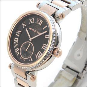 マイケル コース 煌びやかなラインストーンをまとったコンビカラーのラグジュアリーなレディス腕時計。見やすい大き目サイズ。 MK5957