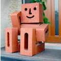 お庭の玉手箱看板息子のれんがマン いつでも笑顔でみんなをお迎えします