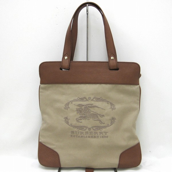 c5f68ef9f00b  color  Brown X beige  material  Canvas X leather  specifications  The  outside  There is no pocket. The inside  Pocket  1 opening pocket  2 with  fastener