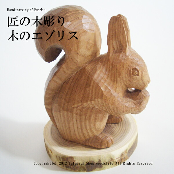 Wood l is a carved wooden squirrel squirrel wood carving sophora